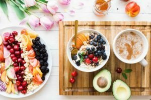 Bowls of fruit, flowers, avocados, and coffee